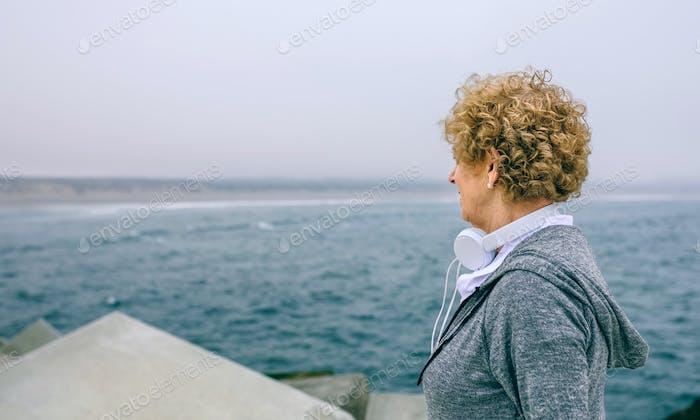 Senior sportswoman looking at the sea