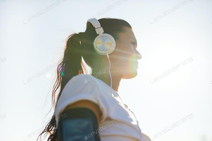 Purposeful lady in sunlight