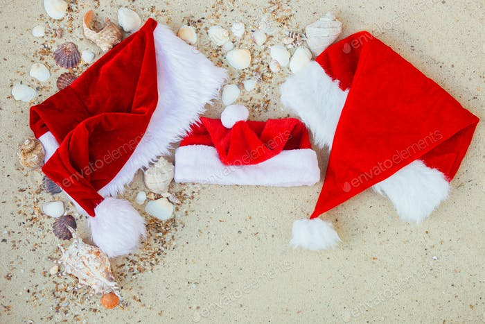 Thumbnail for Christmas hat on the beach. Santa the sand near shells.New year vacation.