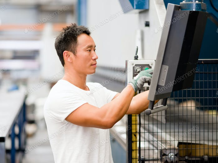 Asian worker in production plant on the factory floor