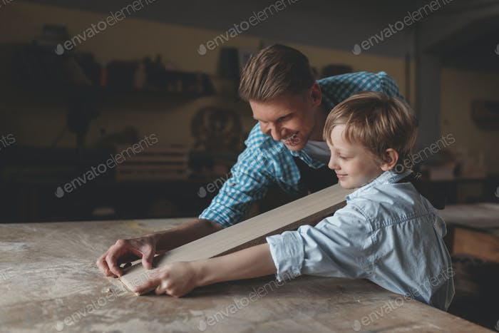 Father and son with a plank