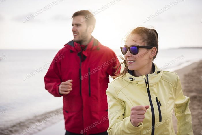 Couple jogging in the bad weather