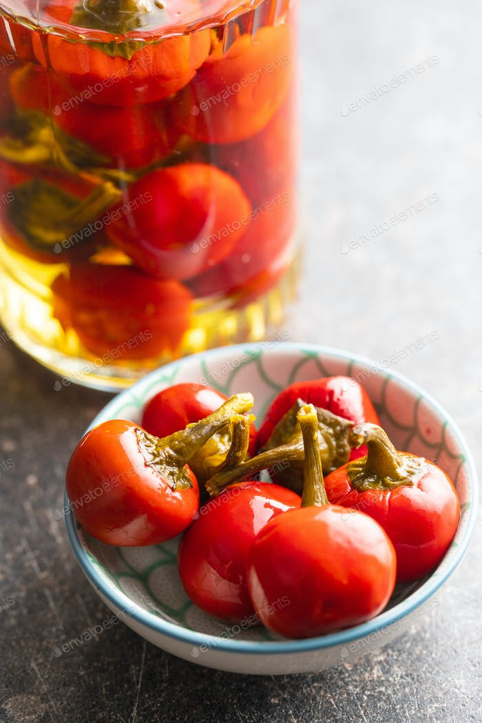 Pickled hot chili peppers.