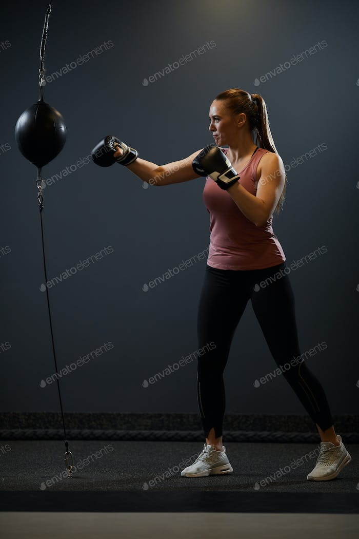 Young Woman Boxing on Black