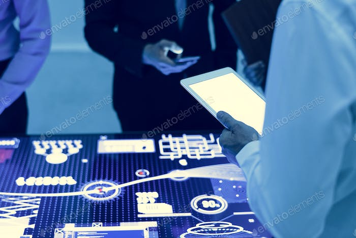Hands holding using digital tablet in a technology meeting