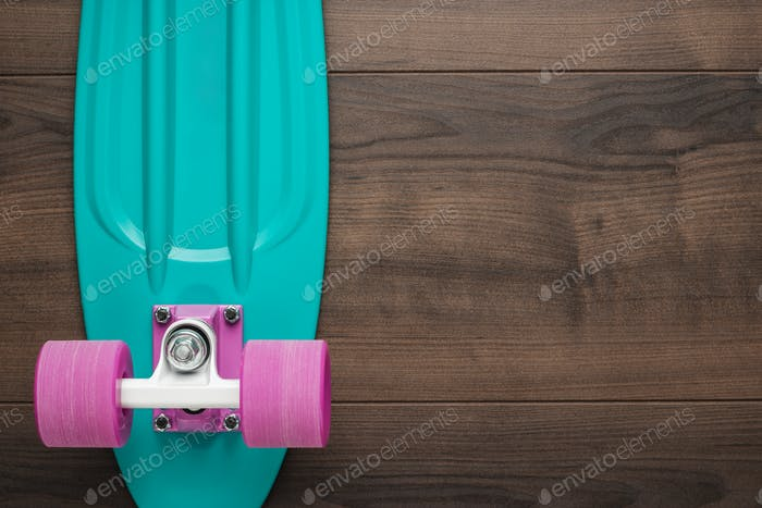 Mini cruiser board on wooden background