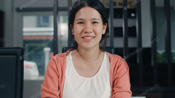 Portrait young Asian Pregnant women relax toothy smile looking to camera at home.