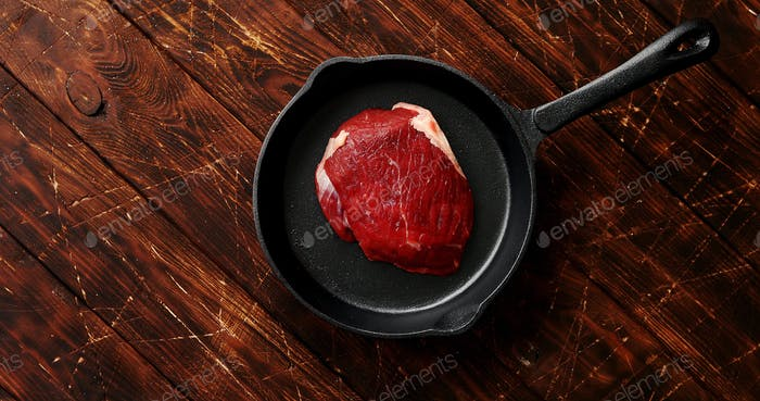Piece of meat laid on pan