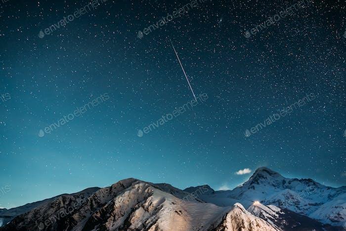 Stepantsminda, Georgia. Natural Winter Night Starry Sky With Glo