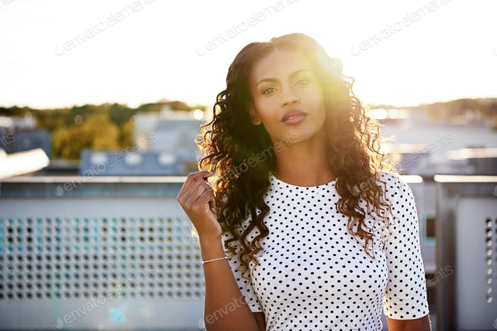 Gorgeous calm young woman touching hair