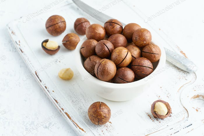 Plate with almonds in endocarp, whole and chopped open nuts in bulk