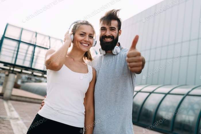 Portrait of young attractive happy fitness couple