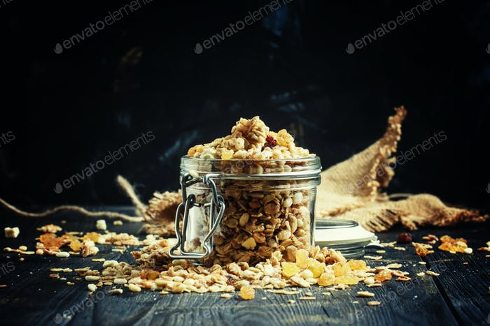 Baked muesli with raisins and sunflower seeds in a glass jar