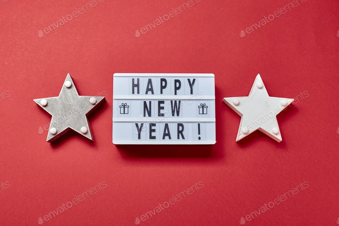 Light box inscription Happy New Year and wooden decorations