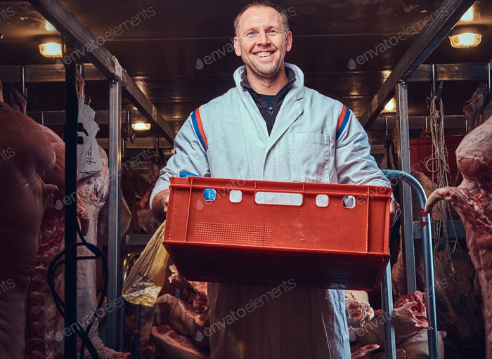 The butcher in a meat freezer.