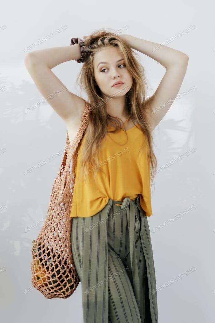 Girl with a reusable bag