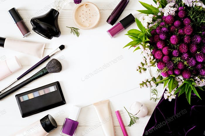 Fashion mockup decorative cosmetics background with flowers. Top view. Flat lay
