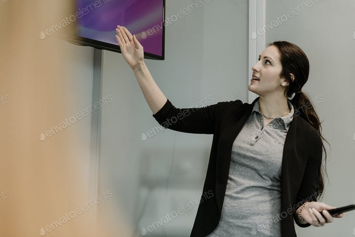 Professor pointing to TV