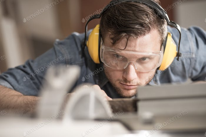 Carpenter using protective headphones