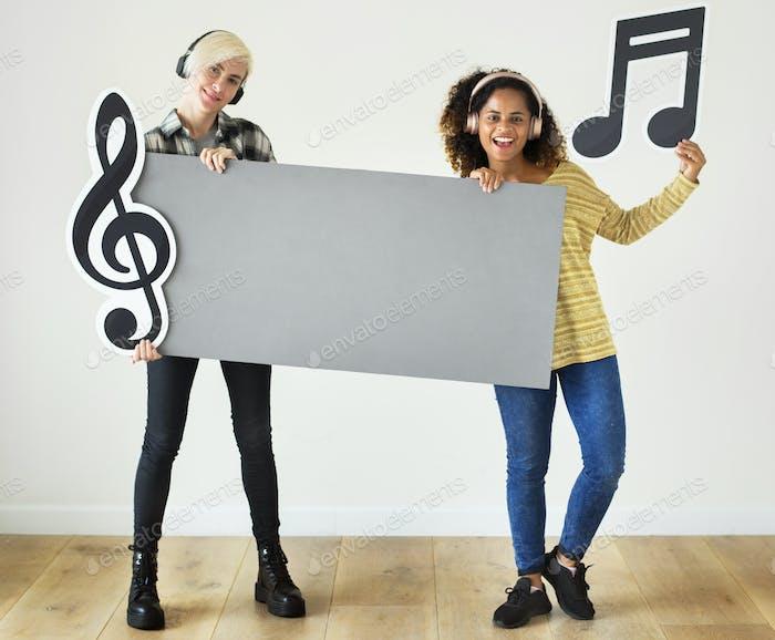 Young women enjoying music icons