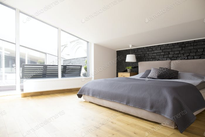 Grey bright bedroom interior