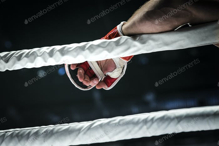 closeup hand of fighter MMA in glove