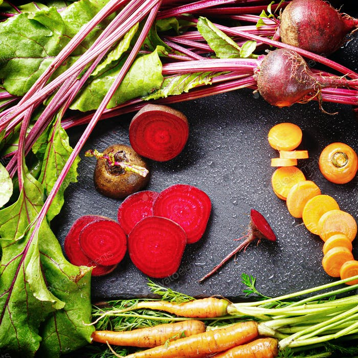 Top view at vegetable background of beets and carrots on kitchen