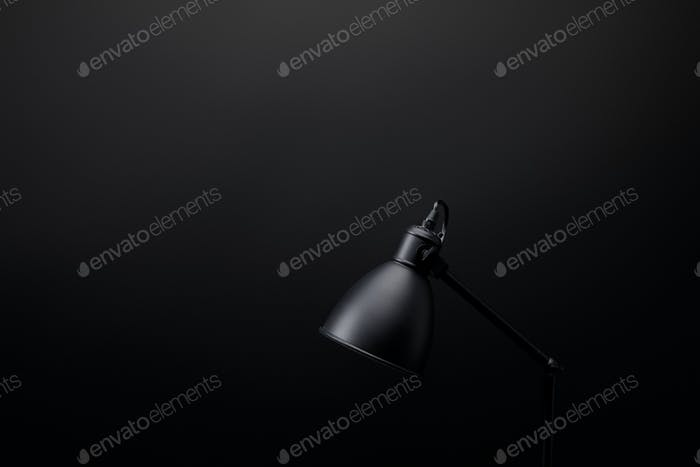 close up view of black lamp on black wall background