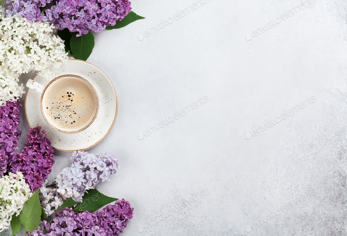 Colorful lilac flowers and coffee cup