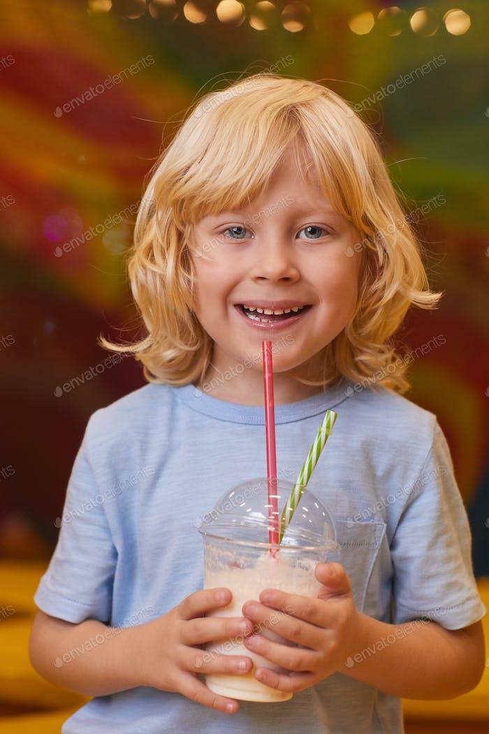 Child drinking milk cocktail
