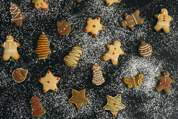 Holiday biscuits on snowy sugar background