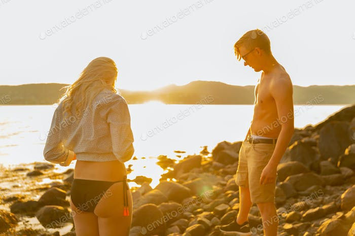 Young Couple Enjoying Summer Vacation At Beach