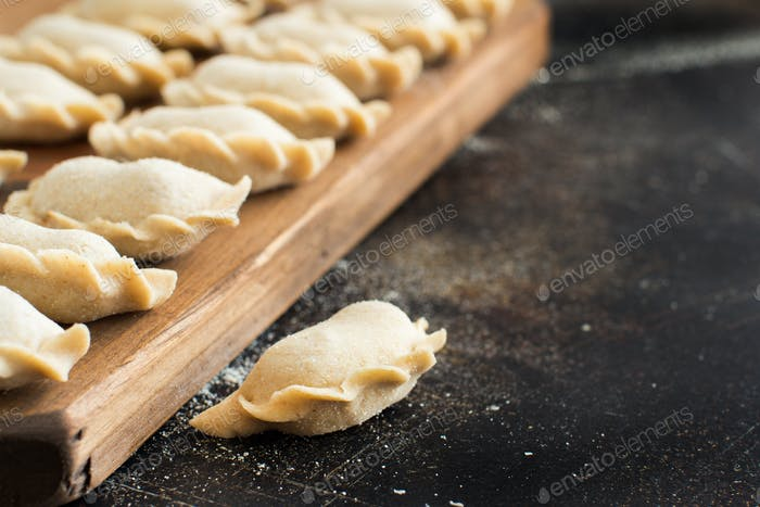 Raw meat pelmeni, ravioli, dumplings