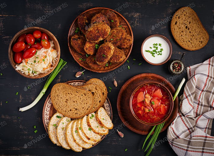 Traditional Ukrainian Russian borscht or red soup with juicy delicious meat cutlets