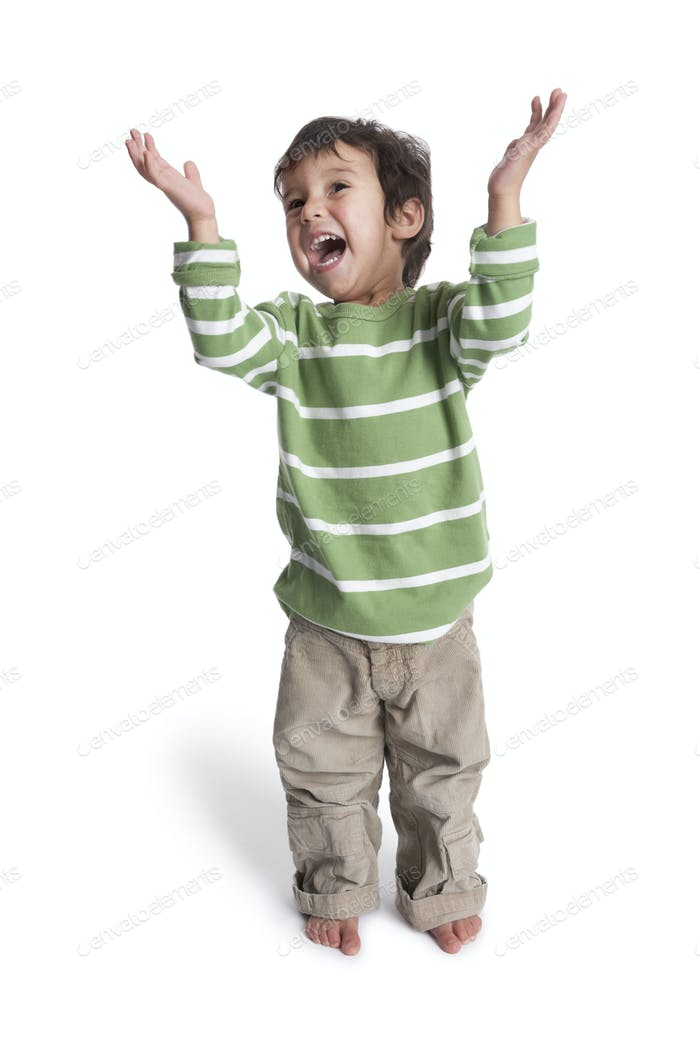 Happy singing two year old boy with his hands up