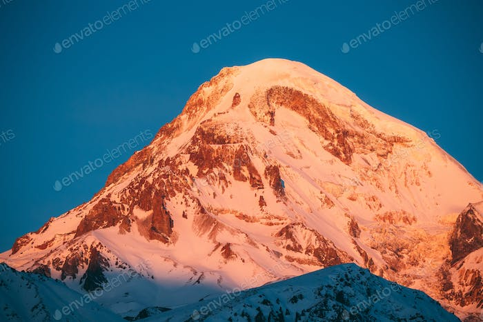 Georgia. Mount Kazbek Covered Snow In Winter Sunrise. Morning Da