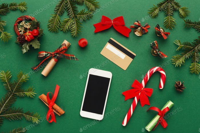 Smartphone, christmas decorations and credit card