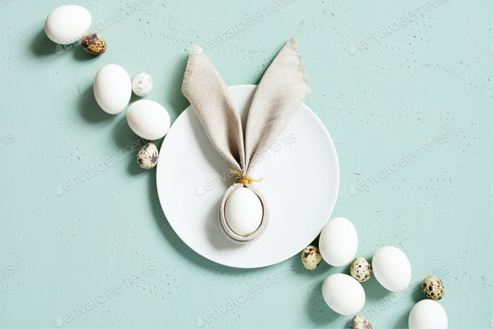 Easter Bunny of Linen Napkin and Eggs on the Plate