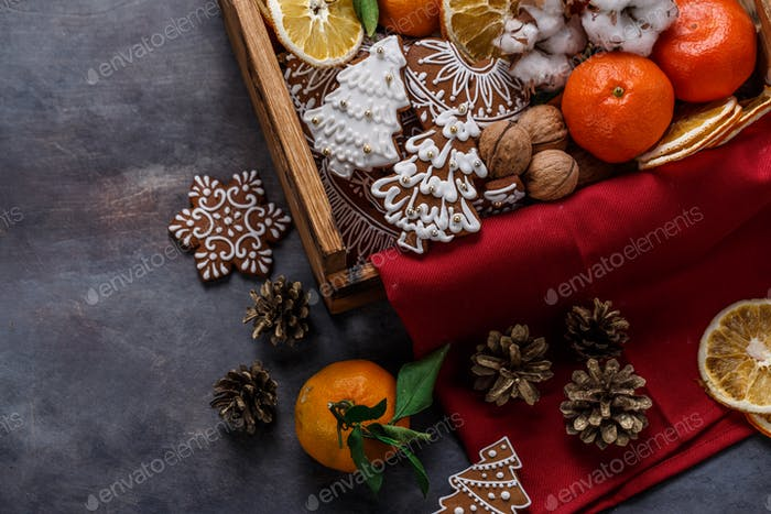Gingerbread cookies, dry oranges, tangerines and nuts for christmas decoration, copyspace