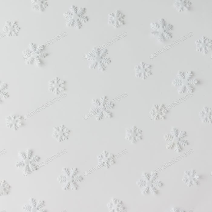 Creative winter snowflakes pattern. Minimal holidays concept. White background.