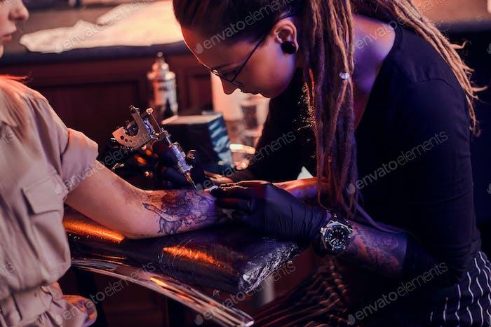 Process of tattoo makining at cozy tattoo salon