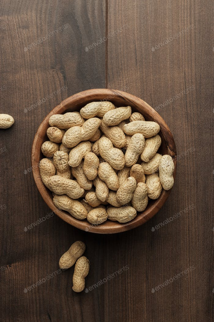 Peanuts In Wooden Bowl On The Table
