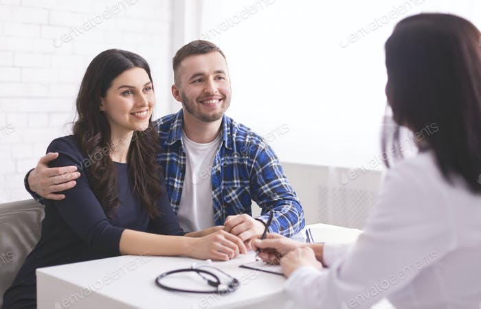 Young couple at doctor's appointment at clinic