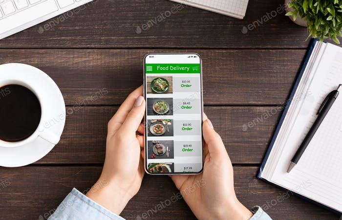 Hand touching phone screen for choosing food
