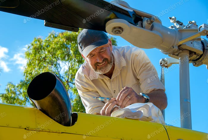 Engineer maintaining a helicopter
