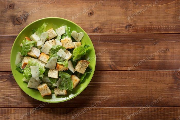 caesar salad in plate at wood