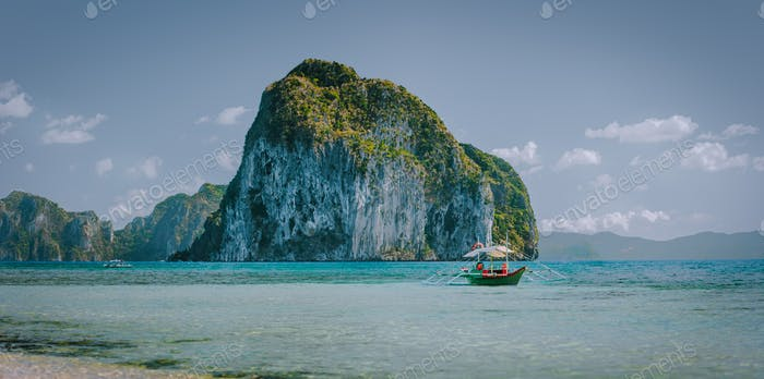 Panorama scenery of El Nido coastline. Philippino image Pinagbuyutan island in background and local