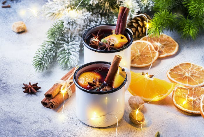 Mulled wine in white metal mugs