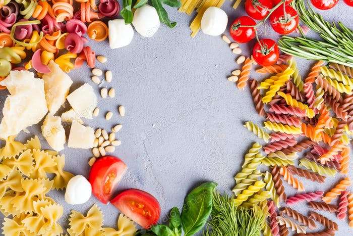 Italian food. Pasta ingredients on stone table. Top view with space for your text