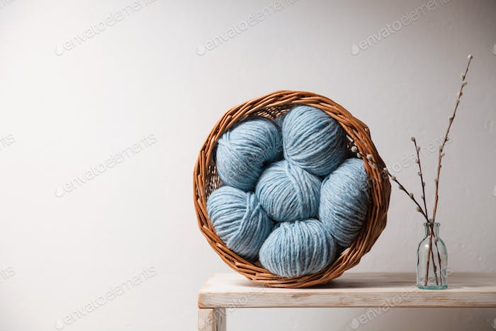 Closeup of basket with colorful yarn clews